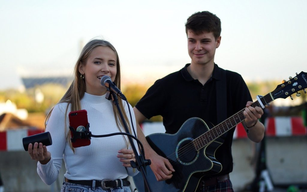 Couple of young musicians performing